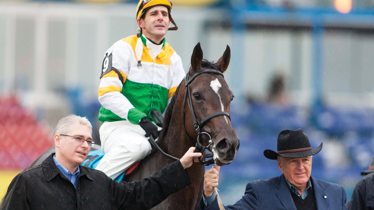 Chiefswood's Mark Krembil (left) and his father Bob Krembil with Nipissing after winning the 2013 Woodbine Oaks. (Dave Landry photo)